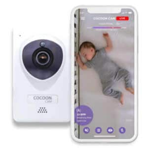 white cocoon cam plus with a phone showing the app