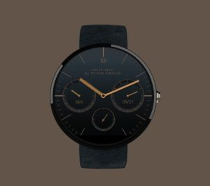 a black and bronze watch face with a classic design