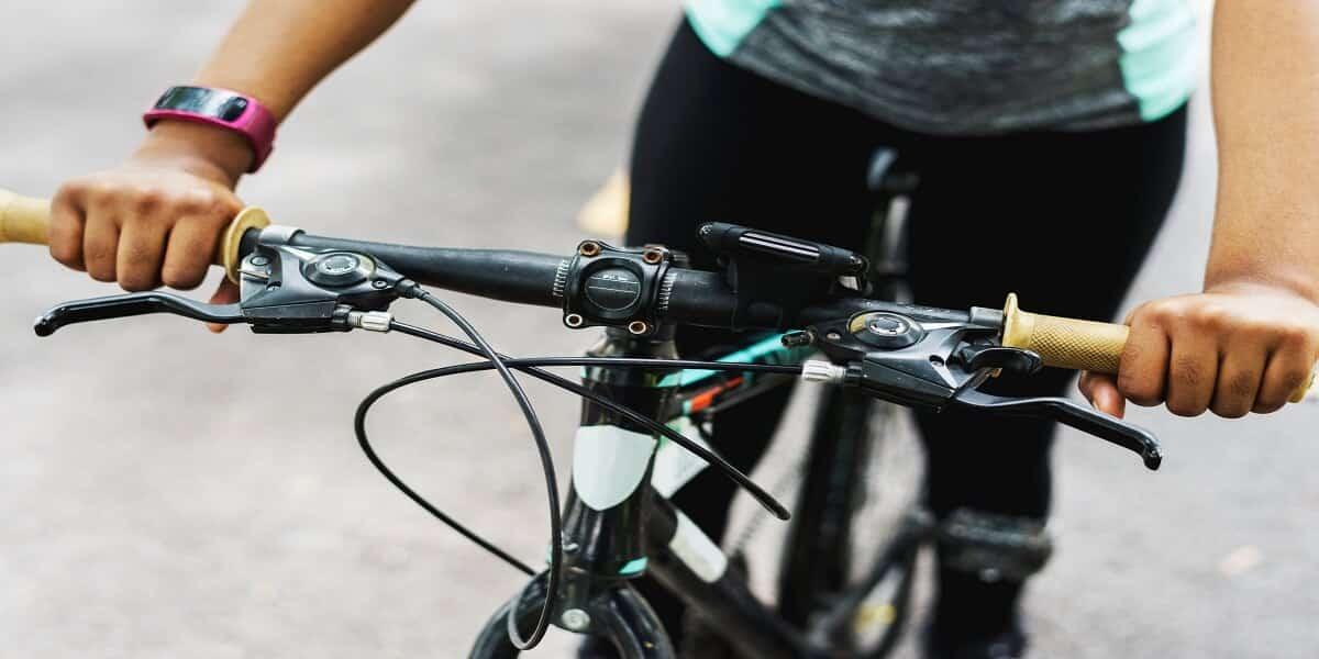 man-riding-black-and-white-mountain-bike