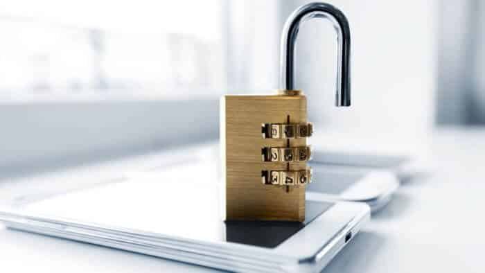 a padlock sitting on top of a smartphone