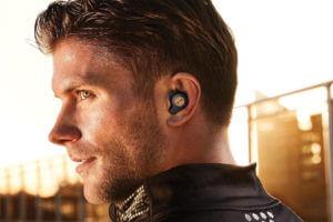 a man wearing truly wireless earbuds
