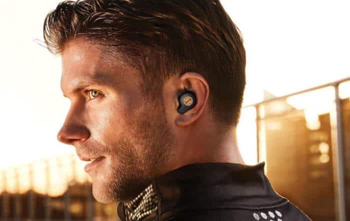 a man wearing truly wireless earbuds