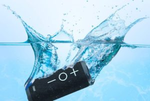 a bluetooth speaker submerged in water