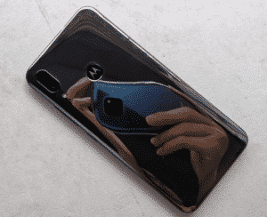 """The rear features two cameras and a fingerprint scanner underneath the iconic """"M"""" logo"""