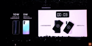 Xiaomi CEO Lei Jun demonstrating how much faster the phone is at wirelessly charging an iPhone than the Huawei P30 Pro