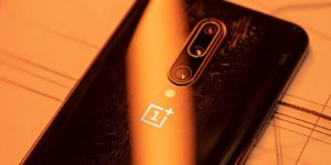 The back design of the OnePlus 7T Pro 5G McLaren features a black and orange color scheme with a delicate pattern