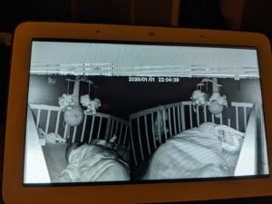 A person is picking up feeds from other people's camera and images include random sleeping and infant in a cradle