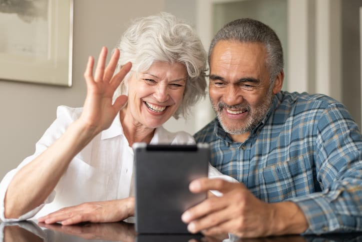Elderly couple video chatting with loved ones