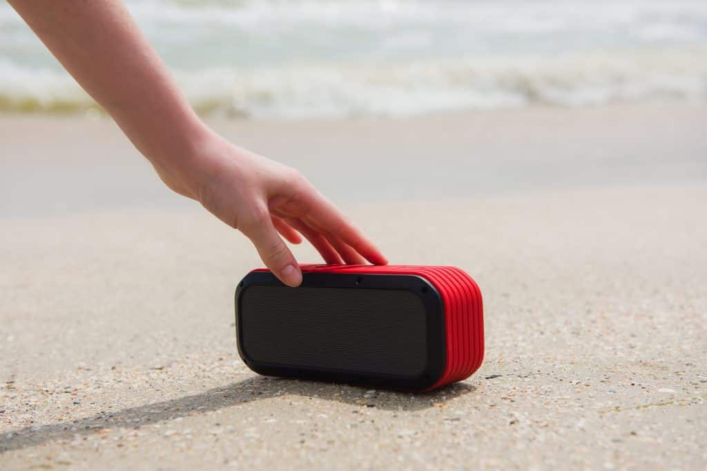 Best potable speakers for Android - female hand touching portable speaker